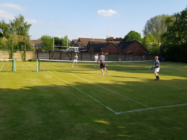 Tennis members playing doubles